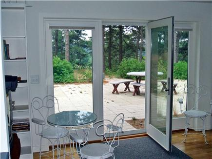 Wellfleet Cape Cod vacation rental - View from inside to outdoor, private patio eating area.