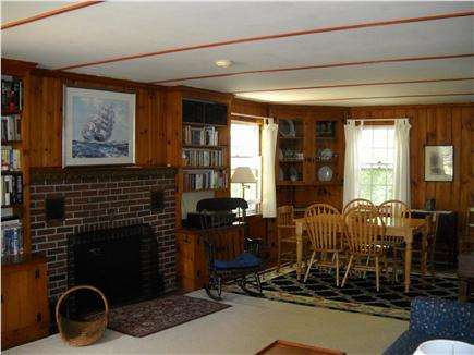 Brewster Cape Cod vacation rental - Spacious living room with fireplace opens to dining area