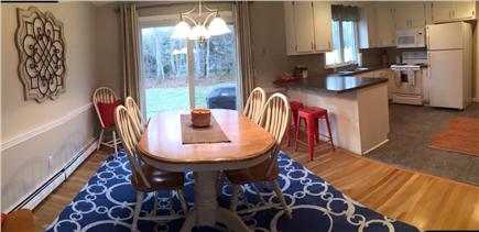 Dennis Cape Cod vacation rental - Kitchen and dining area with slider to new back patio