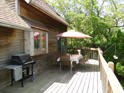 Harwich Cape Cod vacation rental - Deck with grill and dining table, overlooking back yard