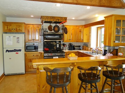 Harwich Cape Cod vacation rental - Kitchen area with breakfast bar, adjacent to dining room