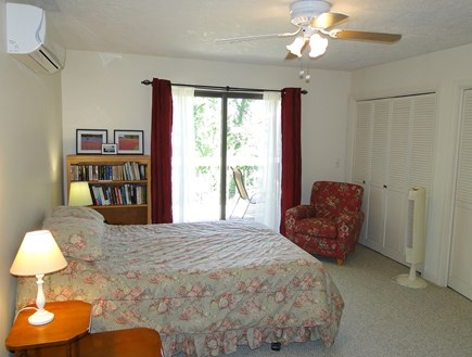 Harwich Cape Cod vacation rental - Queen Master bedroom on first floor with slider to deck