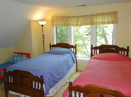 Harwich Cape Cod vacation rental - Upstairs twin bedroom with smaller toddler bed too