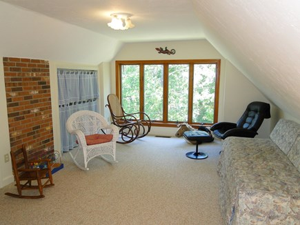 Harwich Cape Cod vacation rental - Loft area upstairs with toys and day bed