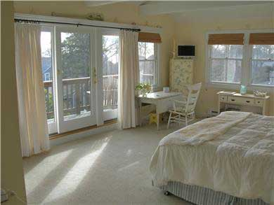Mashpee, Popponesset Cape Cod vacation rental - Large master with plenty of windows, deck & view