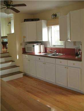 Mashpee, Popponesset Cape Cod vacation rental - Stairs from kitchen to eating area