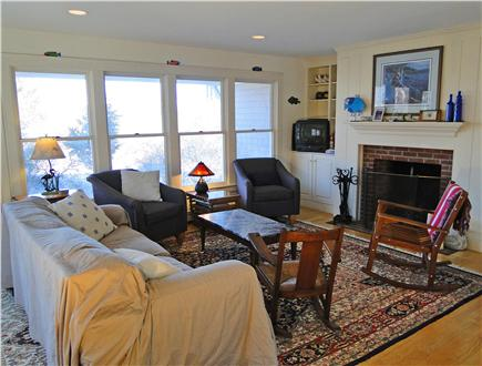 Brewster Cape Cod vacation rental - Downstairs living room w/ fireplace, door towards deck and dunes