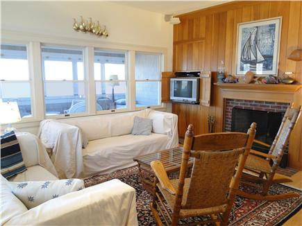 Brewster Cape Cod vacation rental - Upstairs living room with fireplace, door to sun porch