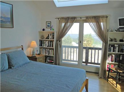 Brewster Cape Cod vacation rental - Master bedroom upstairs - has private balcony overlooking water