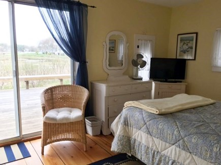 Dennisport Cape Cod vacation rental - Master bedroom w/queen bed, sliders to the deck & water views