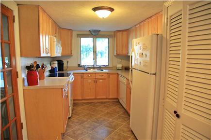Sandwich (Town Neck) Cape Cod vacation rental - Kitchen with Washer/Dryer in Closet