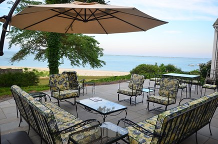 Chatham Cape Cod vacation rental - Outdoor dining terrace with views of harbor and Atlantic.