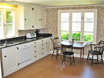 Chatham Cape Cod vacation rental - Eat-in kitchen with fireplace.