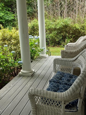 Brewster Cape Cod vacation rental - Front shade porch with wicker chairs for relaxing.