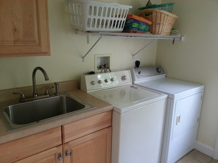 Brewster Cape Cod vacation rental - Laundry room off of kitchen with separate utility sink.