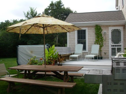 Brewster Cape Cod vacation rental - Back deck with hot tub to the right and gas grill to the left.