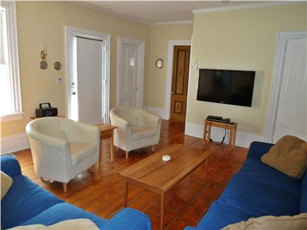Dennis Cape Cod vacation rental - Large, bright family room -seats 7 comfortably (flat screen tv).