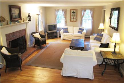 Brewster (Sheep Pond) Cape Cod vacation rental - Spacious and open living room with fireplace, TV/DVD player.