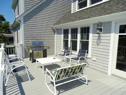 Chatham, Hardings Beach Area Cape Cod vacation rental - Large deck with seating and grill, overlooking large back yard
