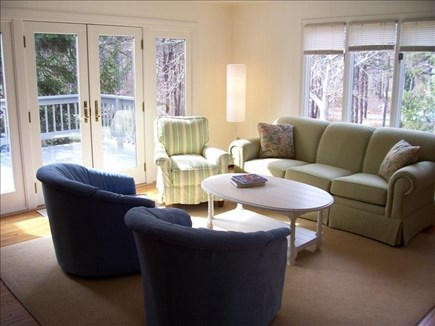 Wellfleet Cape Cod vacation rental - Large sunny living room with french doors to front deck