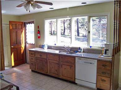 Wellfleet Cape Cod vacation rental - Large bright kitchen with door to back deck Will be all new 2018