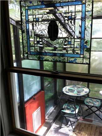 Wellfleet Cape Cod vacation rental - Sunroom breakfast nook with dog flap to fenced-in yard
