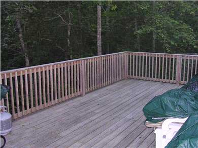 Mashpee, Popponesset Cape Cod vacation rental - Large private deck overlooks wooded conservation land.