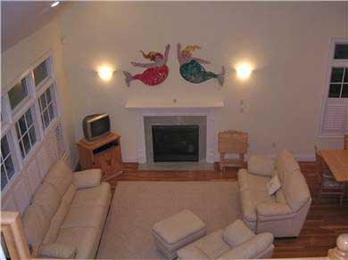 Mashpee, Popponesset Cape Cod vacation rental - Living space with gas fireplace.