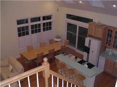 Mashpee, Popponesset Cape Cod vacation rental - Oversized dining table with padded chairs.