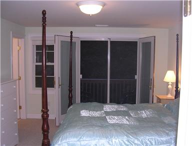 Mashpee, Popponesset Cape Cod vacation rental - Master bedroom with balcony doors open.