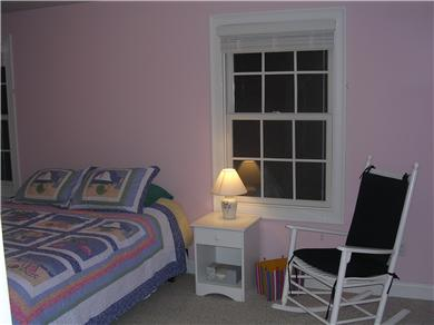 Mashpee, Popponesset Cape Cod vacation rental - Pink guest room with queen and twin beds.