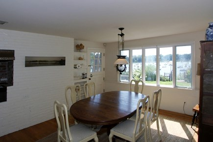 East Orleans Cape Cod vacation rental - Bright dining room with water views and door leading to terrace