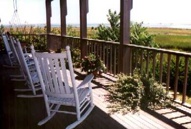 North Chatham Cape Cod vacation rental - Lower mohagany  deck with  rockers, swing
