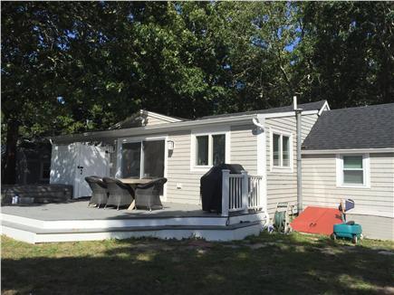 Dennisport Cape Cod vacation rental - Back of house, deck, shower, hot tub