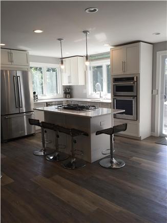 Dennisport Cape Cod vacation rental - Open concept, modern kitchen & dining area w/sliders to deck