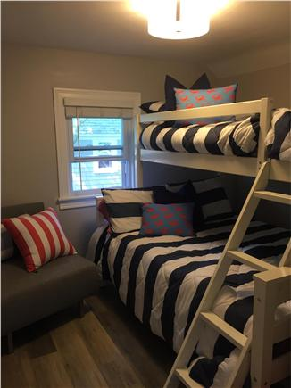 Dennisport Cape Cod vacation rental - Bunk room sleeps 4.  The grey chair pulls out to a twin bed.