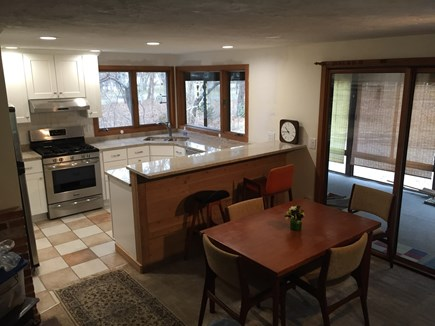 East Sandwich Cape Cod vacation rental - New kitchen - 2017 - open spacious look.Dining table, snack bar