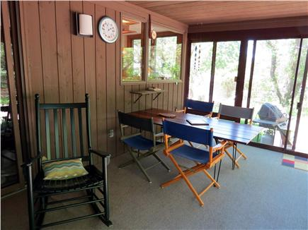 East Sandwich Cape Cod vacation rental - Table on porch easily seats six.  Pass through window to kitchen.
