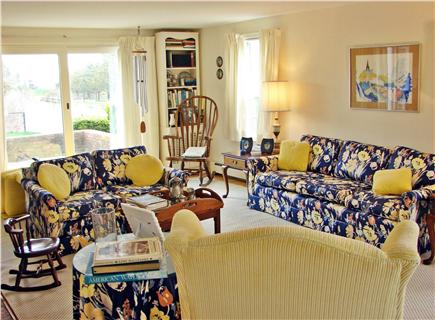 Near Lighthouse beach/Chatham Cape Cod vacation rental - Lovely bright living room with slider to patio and pool
