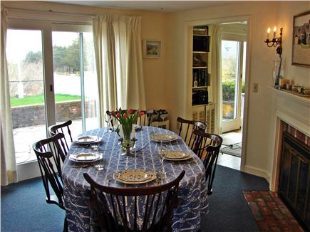 Near Lighthouse beach/Chatham Cape Cod vacation rental - Dining room with fireplace and slider to patio and pool