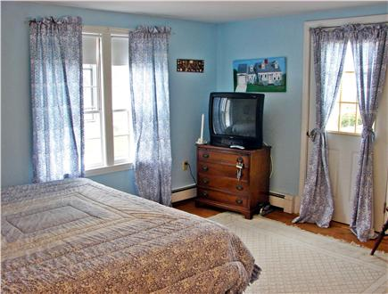 Near Lighthouse beach/Chatham Cape Cod vacation rental - Master bedroom with door to pool area