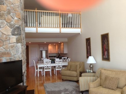 Falmouth Heights Cape Cod vacation rental - Living/dining area with open loft above with more seating
