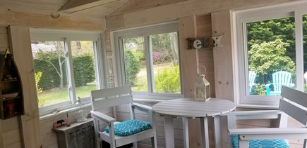 Eastham Cape Cod vacation rental - Dining and relaxing furniture in enclosed porch