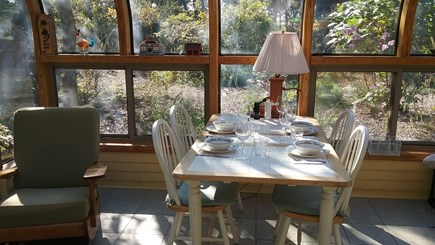 Wellfleet Cape Cod vacation rental - Screened sunporch dining area overlooking garden