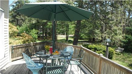 Brewster, north of 6A Cape Cod vacation rental - Relaxing, sunny deck. Table seats 6
