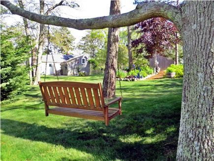 Barnstable Cape Cod vacation rental - Enjoy the swing and spacious yard for relaxing.