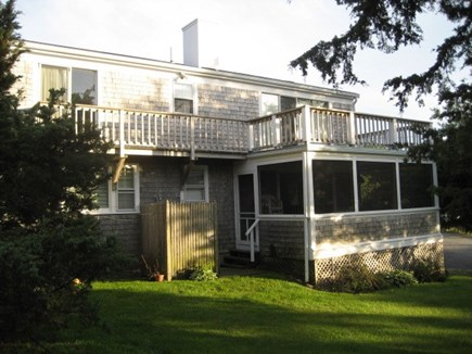 Dennis Cape Cod vacation rental - fully screened in porch with upper deck for sunset views