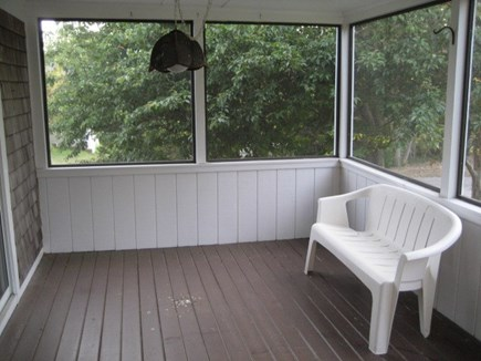 Dennis Cape Cod vacation rental - Fully screen deck with table and chairs for 10