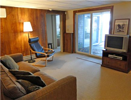 Brewster Cape Cod vacation rental - Lower level family room with slider to back yard