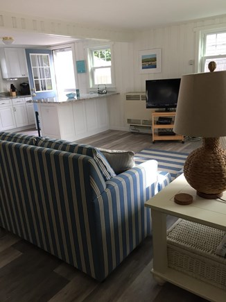 Dennisport Cape Cod vacation rental - Brand new open concept living room/ dining area- new flooring.